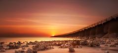Beach of Bones (Nomadic-Imagery) Tags: longexposure light sunset sea bali orange sun water coral island twilight dusk scenic calm illuminated coastline tetrapod tranquil goldenhour tetrapods inodnesia bw10stopndfilter canoneos5dmark2 canon24105mmf4lislens