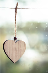 Heart on a string (WillemijnB) Tags: wooden heart coeur hart hertze romantique romantic liefde love amour bokeh window raindrops string