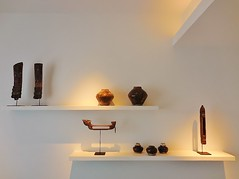 Cambodian style (SM Tham) Tags: asia cambodia siemreap viroths hotel bedroom guestroom interior wall shelves objetdart antiques woodcarvings jars lighting spotlights indoors pottery pots