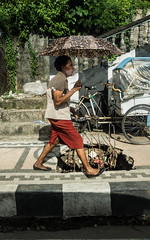 Ambon (mauriceweststrate) Tags: indonesia kotaambon ambonmanise danger dangerous hole indones maluku mauriceweststrate mindyourstep molucca moluccas sinkhole street streetlife streetphotography umbrella walking woman