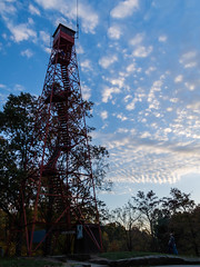 Fire Watch Tower (dmltraveler) Tags: fire watch tower tall red high blue sky clouds trees autumn fall colors yellow green orange father son mother wife husband composition mohican state park ohio antenna