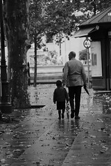 Father and Son (xiaolifra) Tags: shadow siviglia walking espana spain lights chance portraits picoftheday photo moment time bridge amazing colorful dark blackwhite black simply emotions