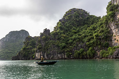 Halong Bay (bienve958) Tags: halongbay vietnam qungninh vn worldheritagesite unesco islands islas paisaje landscape seascape sea water rocks fisher woman ship sudeste asiaticosoutheast asia paradise saling sky