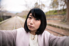 Young woman taking selfie picture on dead railroad track (Apricot Cafe) Tags: 20s asianethnicity japan japaneseethnicity kyoto minikyoto2016 sigma20mmf14dghsmart autumn autumnleaves beautyinnature change charming cheerful enjoying foliage freshness happiness hope japanesefallfoliage japanesemaple leaves mapleleaf nature oneperson onlywomen outdoors people railroadtrack refreshing selectivefocus selfie takingpictures tranquility traveldestinations walking wishing woman youngadult