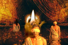 Underworld (lisaleo2) Tags: underworld tunnel river water lethe charon hades hell greece greek myth mythology death afterlife flame candle fire glow blindfold wading man woman walls reflection dark red yellow gold fantasy digital collage