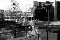 Keep on truckin' (John fae Fife) Tags: fujifilmx noiretblanc urban luxembourg monochrome roundabout pedestrians bw trucks blackandwhite nb street xe2