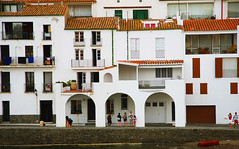 Puzzle (angelsgermain) Tags: houses faades balconies windows doors archway arches sidewalk beach sand water waterfront boat roofs ribapitxot cadaqus altempord costabrava catalonia catalunya