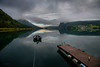 Stillness (alexring) Tags: sky water oppstrynsvatnet sognogfjordane norway stryn flo mountain mist low clouds mirror jetty rope boat mooring reflection lake moody view morning alexring nikon d750
