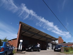 massive chemtrail runs the course of the Severn in Welshpool (rospix) Tags: uk blue sky sun cars nature june wales countryside garage chemtrail 2014 globaldimming geoengineering weathermanipulation rospix solarradiationmanagement stratosphericaerosolspraying