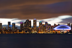 cityscape | toronto. (alyssaBLACK.) Tags: longexposure sky lake toronto ontario canada water skyline architecture clouds canon buildings lights cityscape cntower cityfront
