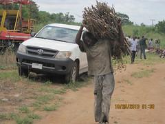 Happy farmer receives improved cassava stems for multiplication (IITA Image Library) Tags: nigeria cassava oyostate manihotesculenta improvedvarieties iitacta iseyin