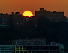 Sunset caught me by surprise. (Gimo Nasiff) Tags: new nyc trees sunset summer orange sun sol canon buildings de atardecer ditch north nj samsung telephoto half surprise jersey hudson bergen dslr 70300mm heights puesta hidding gimo nx30 nasiff