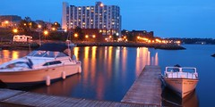 Harbour Lights (BluePrince Architectural) Tags: sunset summer canada reflection water landscape boats hotel boat twilight dock ship novascotia sundown harbour yacht dusk ships sydney quay lensflare mooring capebreton bluehour yachts motorboats motorboat sydneyharbour pleasurecraft