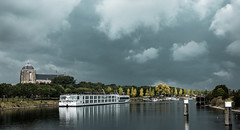 A storm is coming (Wouter de Bruijn) Tags: fujifilm xt1 fujinonxf35mmf14r veere walcheren zeeland ship cruiseship cruiseboat water canal church churchtower trees fall autumn storm nature weather dark clouds foreboding outdoor landscape