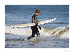 Longsands Surfer (Seven_Wishes) Tags: newcastleupontynenortheast kc canoneos1dmarkiv canonef100400mmf4556lisii photoborder outdoor tynemouth longsands beach people candid coast sea water surfer surfboard wave splash wetsuit rubber man candidportraits sporting blue sport