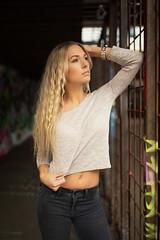 old car park II (Michael Kremsler) Tags: shooting model girl blond bellytop jeans tresses grid rust graffiti availablelight bokeh hallway carpark portrait fashion streetfashion