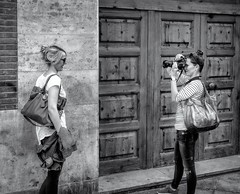 Photosession BW (aistora) Tags: black white bw blackandwhite mono monochrome film analog paper print contrast grain zoom crop focus women ladies females tourists photographer model pose posing portrait ambient street candid passingby canon dslr urban city town old antique medieval valencia spain oldcity oldtown citadel centre historic sony alpha ilce a6000 zeiss lens 24mm f18 sel24f18za lightroom pse topaz nik silverfx