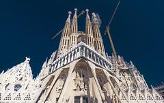 Sagrada Familia (klepher) Tags: barcelone barcelona trip sky blue dark polariser hoya filter shoot photography travel tourism cathedrale church gaudi art crazy work construction man human notfinish hd view city europe catalunya