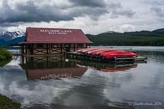 Maligne Lake (NettyA) Tags: 2014 alberta canada canadianrockies jaspernationalpark malignelake northamerica sonynex6 boatshed canoes cloudy lake mountains red reflection travel malignelakeboathouse