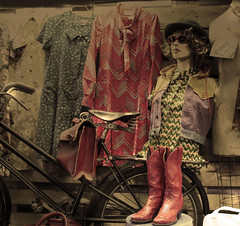 Buygone Days (dawn_macroart) Tags: vintage florence fashion italy display dresses boots bike processing colour