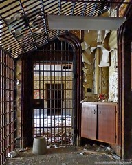 Locked up. More here: http://www.placesthatwere.com/2016/11/inside-joliet-correctional-center-abandoned-prison.html #prisonbars #peelingpaint #abandoned #locked #neogothic #architecture #entryway #arch #abandonedplaces #abandonedbuilding #illinois #decay (placesthatwere) Tags: abandoned urbanexploration ghosttowns urbex rurex abandonedplaces forgottenplaces urbandecay decay beautifuldecay