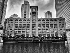 Imposing (ancientlives) Tags: chicago chicagoriver illinois usa travel riverwalk streetphotography monochrome mono blackandwhite bw monday december 2016 autumn clouds weather sky walking loop skyline cityscape downtown architecture buildings
