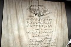 Script on a scroll.