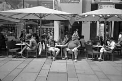 Coffee break with beer (Franco & Lia) Tags: vienna street blackandwhite film analog austria sterreich noiretblanc epson rodinal ilford fp4 biancoenero argentique pellicola analogico v500 r09 nikonl35af2