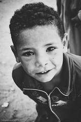 Pure | PEACE Activists (alifakmal) Tags: boy blackandwhite bw smile kitlens potrait d7000