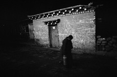 A monk ,  Passing by at late night (SungsooLee.com) Tags: china street leica trip travel people film silhouette night analog asia buddhist 28mm monk buddhism tibet monastery journey tibetan mp sichuan f28 tibetanbuddhism sertha larunggar tibetautonomous buddhismacademy