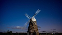 One Lonely Night (Tim van Zundert) Tags: sky moon west abandoned windmill night fence downs stars sussex timelapse video long exposure sony south voigtlander derelict goodwood chichester 21mm ultron halnaker a7r