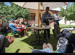 Just arrived at 3500 meters - Important to take it easy (vegarste) Tags: shadow summer people india feet trekking garden relax high nikon legs tea drink hiking altitude arrive hikers himalaya elevation leh ladakh d800 acclimatization kashmirandjammu