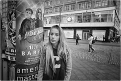 Love Berlin (Steve Lundqvist) Tags: black white bw blackandwhite monochrome berlin berlino deutschland germania germany alexanderplatz portrait ritratto street streetphotography nikon nikkor 24mm girl pole advertising pubblicit sweatshirt jacket fashion moda