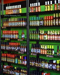 Spicy Saucy (irishbartender) Tags: color colorful sauces spicy hot red green bottles shelves fishermanswharf sanfrancisco california rows nikon d7000