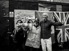 Piccadilly Rats (The Green Hornet ( Manchester)) Tags: piccadilly rats manchester buskers band punk rock rockandroll guitars trolley rat policeman helmet union jack british flag backdrop documentary people music live group street photography ricoh gr monochrome black white city centre