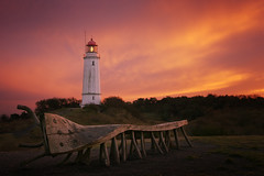 Fire in the Sky (parkerbernd) Tags: lighthouse leuchtturm dornbusch burning sky light sunset hiddensee island baltic sea ruegen bakenberg nature reserve autumn november lumix gx1 germany bench art