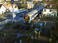 379 006 departing Ware Station, with the 13.05 Broxbourne - Hertford East stopper, passing over Amwell End Crossing. 11 12 2016 (pnb511) Tags: hertfordeast hertfordbranch greateranglia class379 emu trains railways electrostar multiple unit levelcrossing road rail ware spread spreadeagle
