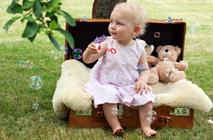 Bubble Fun...... (akal_flickr) Tags: cute girl teddy little outdoor bubbles case innamoramento