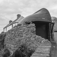 a boat named Foula (Paul A. Rizer) Tags: bw 6x6 scotland blackwhite squareformat shetland lerwick foula fujix100s boatcalledfoula yesthatisagaragewithaboatontop