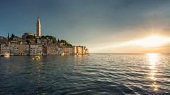 Rovinj (Philipp Klinger Photography) Tags: trees light sunset sea summer vacation sun holiday seascape storm reflection tree tower church nature rain pine clouds landscape boat nikon warm europe mediterranean waves ship south warmth croatia wave churchtower southern filter sunburst burst peninsula rovinj adriatic mediterraneansea cpl adria adriaticsea istria d800 hrvatska balkan southerneurope istra kroatien polarization balkanpeninsula nikond800 gespanschaftistrien