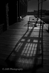 Shadows Fear The Light (jah32) Tags: light shadow blackandwhite bw canada black monochrome dark bench blackwhite nikon shadows darkness monochromatic trainstation trainstations lightroom canadianhistory stthomasontario d7100 cmwdbw