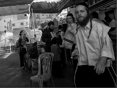 icy stare (harveyfish1) Tags: street people blackandwhite bw woman white man black color colour men girl photography mono israel women candid and haifa