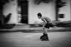 Street Peek (aminefassi) Tags: blackandwhite bw copyright motion blur sport action ef50mmf14 morocco maroc roller rollerblading pan panning rollerskate patin rabat 6d temara rabatsal aminefassi aminefassicom