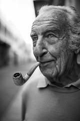 And italian Sir and his pipe (Giulio Magnifico) Tags: life lighting city boss light man black smile closeup composition contrast vintage dark happy lights intense eyes ancient shadows emotion expression character smoke profile pipe citylife culture thoughtful streetphotography streetportrait style smoking elder british essence aged elegant smoker gaze glance genuine eighty udine nikond800e sigma35mmf14dghsm