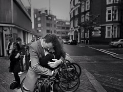 At the end of the day sometimes a hug is enough until tomorrow (Rob Pearson-Wright) Tags: street uk blackandwhite bw woman man london blancoynegro mono hug candid streetphotography streetlife embrace iphone biglens mobilephotography streetphotographybw iphoneography