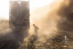 The Road and the Child (Moments2Memories) Tags: 130 child afganistan afghanistan boy conditions danger difficulty dust poverty road travelphotography worker