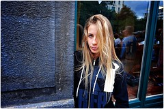 Czech It Out (Steve Lundqvist) Tags: prague praha praga czech republik cecoslovacchia portrait check out street streetphotography sidewalk girl gaze ragazza people nikon nikkor 24mm hair hairstyle eye wall window reflection sweater ritratto strada teen teenager young youth