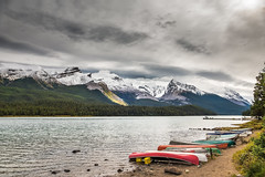 IN A ROW (Sandy Stewart) Tags: lakes canadianlakes lakesinalberta rockymountains landscapes scenicviews canoes colorfulcanoes clouds storms stormylandscapes sandystewartphotography