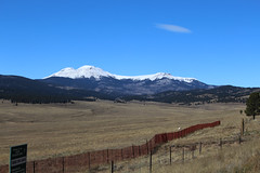 View from US-285 near Como, CO (Phil Spell) Tags: canon colorado mountains trees plants usa unitedstates rockymountains northamerica rocks rockformations snow forest clouds sky mountainside mountainpeak ridge mountainridge plains grass fence sign text