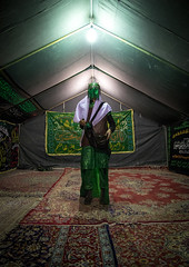 Man inside a tent and dressed as imam hussein during ashura commemoration, Lorestan province, Khorramabad, Iran (Eric Lafforgue) Tags: 1people adult adultsonly ashura calligraphy carpet ceremony clothing colorimage commemoration drama fulllength historicalreenactment hossein imamhussein indoors iran iranian islam khorramabad lookingatcamera man martyrdom memorialevent middleeast mourning muharram muslim onemanonly oneperson periodcostume photography play portrait religion religiouscelebration shia shiism shiite tazieh tent theatre unrecognizableperson vertical lorestanprovince ir